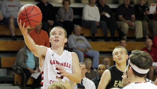 Grinnell College guard Jack Taylor (3), shown during his 138-point performance against Faith Baptist Bible College on Tuesday, scored 21 Sunday in the Pioneers' first matchup since the record-setting game.