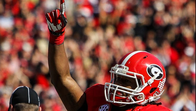Georgia running back Todd Gurley (3) gives a signal of the Bulldogs' preferred ranking Saturday at Sanford Stadium during his team's win over intra-state rival Georgia Tech. Georgia is 3rd in the latest BCS standings.