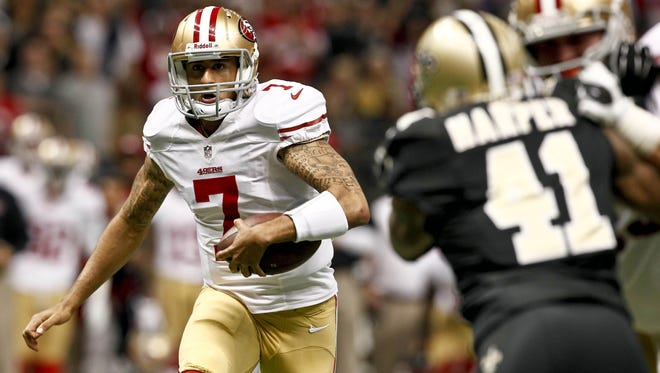 49ers quarterback Colin Kaepernick (7) runs for a touchdown against the New Orleans Saints during the first quarter on Sunday.