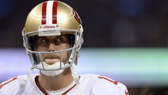 49ers quarterback Alex Smith paces the sidelines, where he stood the entire time during Sunday's win over the Saints.