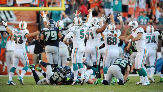 The Dolphins celebrate the game-winning kick from Dan Carpenter (5) on Sunday.