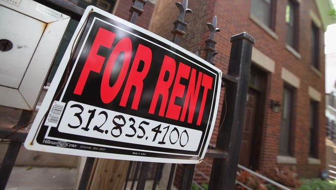 "A ""For Rent"" sign in front of a house in Chicago."