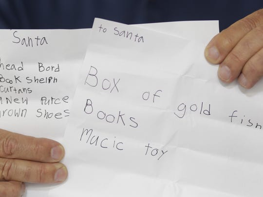Need great as operation santa starts 100th year pete fontana holds up several dear santa christmas letters as head elf fontana runs operation santa which matches the dear santa letters from needy spiritdancerdesigns Images