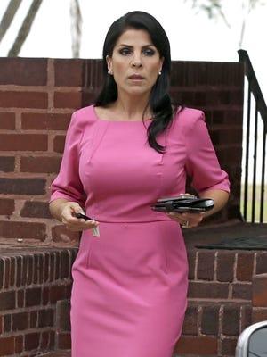 Jill Kelley leaves her Tampa home on Nov 13.