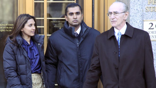 Mathew Martoma, center, leaves a New York City federal courthouse with wife Rosemary and lawyer Charles Stillman on Monday.
