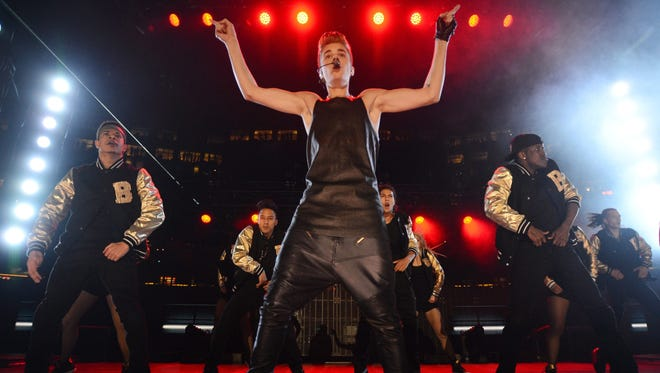 Justin Bieber performs during the halftime show at the CFL Grey Cup championship football game between the Toronto Argonauts and the Calgary Stampeders.