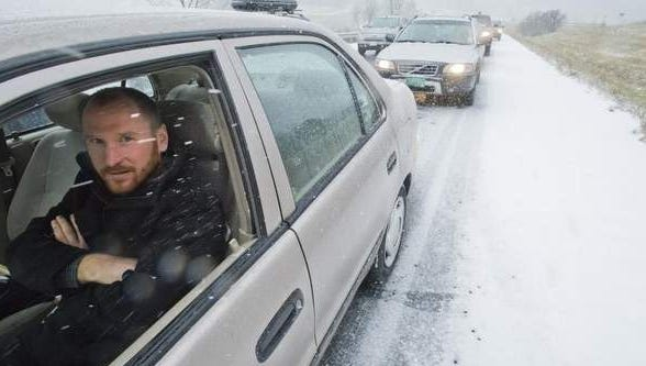 Lindsay Jernigan of Waitsfield, Vt., waits for I-89 to open Monday after snow and accidents brought traffic to a standstill in the Burlington area.