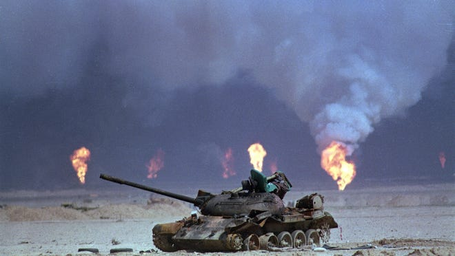 This 1991 file photo shows a destroyed Iraqi tank near a series of oil well fires in northern Kuwait during the Gulf War.  Gulf war veterans exposed to pollution from the fires and other sources face an increased risk of physical and emotional illness.
