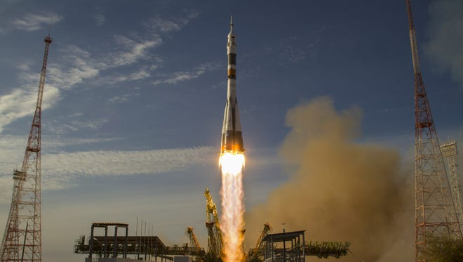 In this handout image provided by NASA, the Soyuz rocket and spacecraft launches to the International Space Station October 23, 2012 in Baikonur, Kazakhstan.