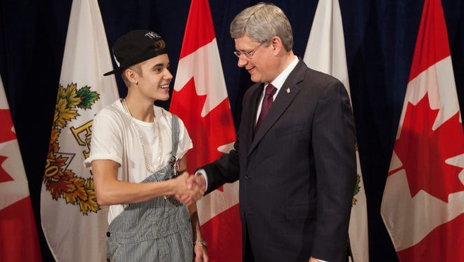 Canadian Prime Minister Stephen Harper, right, was happy to present Justin Bieber with a Diamond Jubilee Medal on Nov. 26 in Ottawa.
