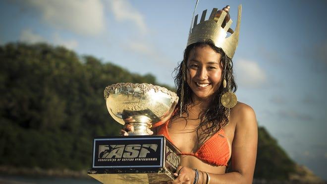Kelia Moniz celebrates her ASP World Surfing victory.