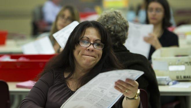 Election clerk Yolanda Martinez inspects ballots on Nov. 7 in Sacramento.