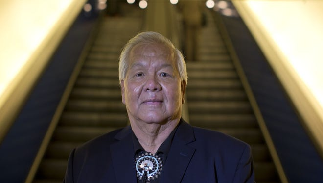 Jim Shee is  one of 10 individuals, and the only Asian to join a civil rights lawsuit against Arizona's controversial immigration law . (Nick Oza /The Arizona Republic)