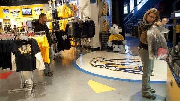 Renee Colthran makes purchases at the Nashville Predators Pro Shop in Bridgestone Arena.