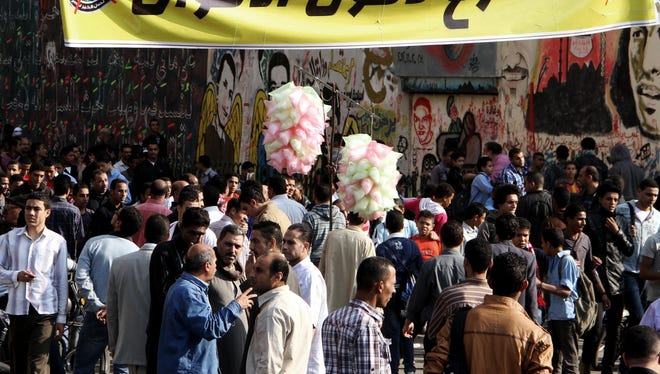 Egyptian protesters gather in Tahrir Square in Cairo on Sunday. President Morsi edicts, which were announced on Thursday, place him above oversight of any kind.