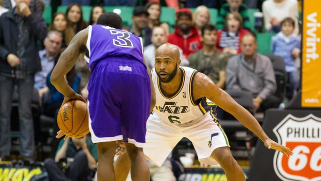 Utah Jazz point guard Jamaal Tinsley (6) defends against Sacramento Kings point guard Aaron Brooks (3). Brooks thought Tinsley fouled him as he drove to the basket, didn't get the call.