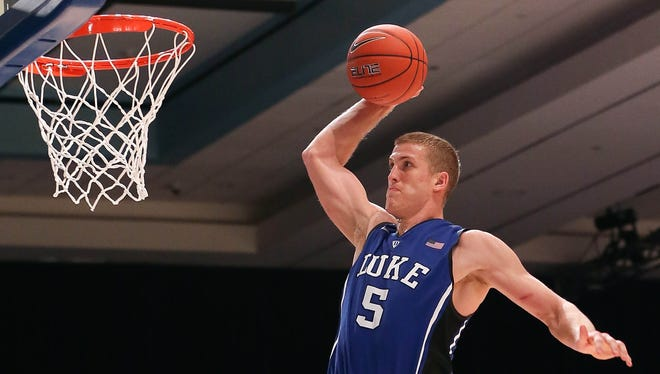 Duke forward Mason Plumlee (5) dunks against the Louisville during the 2012 Battle 4 Atlantis Championship in the Imperial Arena at the Atlantis Resort. Duke won 76-71, its second victory against a top-five team this season.