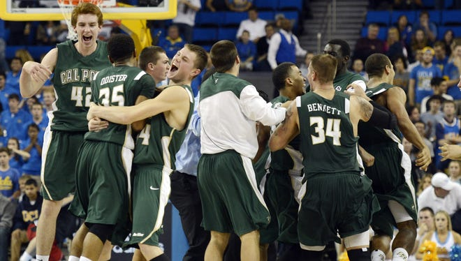 Cal Poly players celebrate after upsetting UCLA 70-68 at Pauley Pavilion.