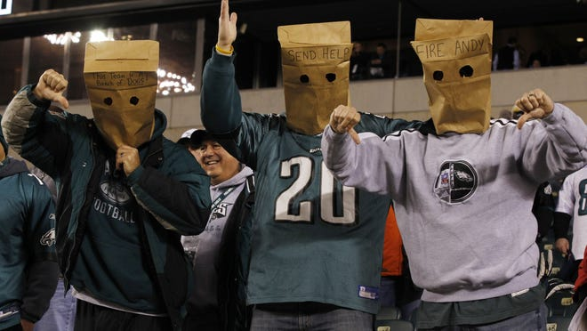 Disgruntled Philadelphia Eagles' fans, wearing paper bags over their heads to show their displeasure with the team and head coach Andy Reid, react for the camera before Monday's game against the Carolina Panthers in Philadelphia.