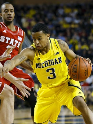 Michigan Wolverines guard Trey Burke moves the ball against the North Carolina State Wolfpack in the first half at Crisler Center.