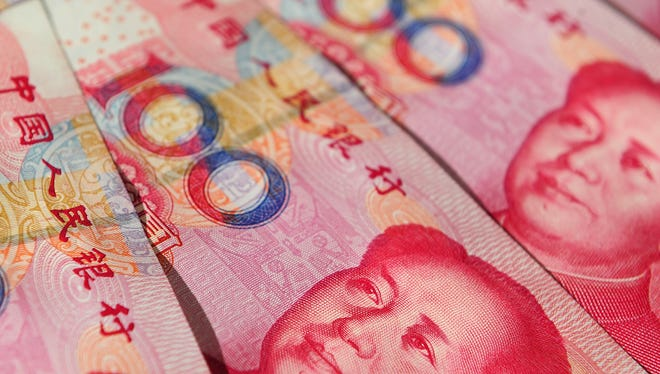Former Chinese Communist Party leader Mao Zedong's image is seen in a display of Chinese 100 Yuan notes.