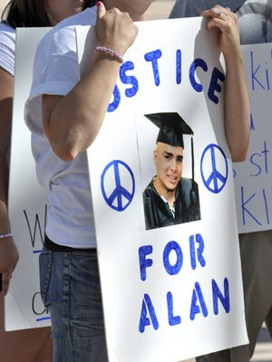 At a June 2011 protest against Albuquerque police, Natalie Gomez clutched a poster featuring a photo of brother Alan, whom officers killed the month before.
