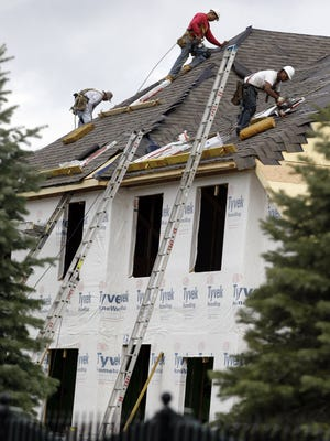 A construction workers finish a roof in Chicago.
