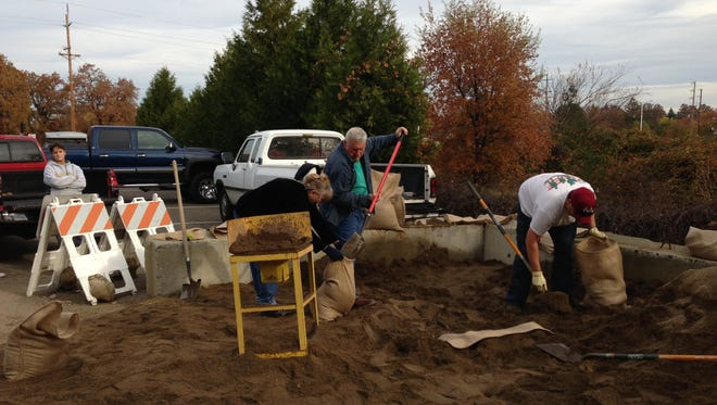 People load up on sand at a fire station in Redding, Calif., on Tuesday. The city offered up to 25 free sandbags to residents in preparation for a series of major rainstorms heading to the region.