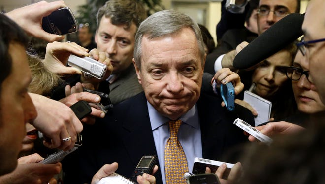 Sen. Richard Durbin, D-Ill., meets with reporters on Capitol Hill on Nov. 13.