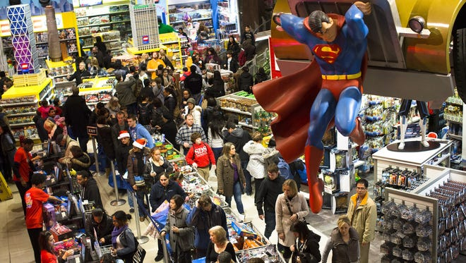 Shoppers wait to check out in the Times Square Toys-R-Us store, which opened at 8 p.m. thanksgiving night.