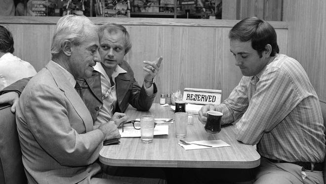 Marvin Miller, left, talks with Houston Astros pitchers Joe Niekro, center and Nolan Ryan at a coffee shop prior to labor negotiations in New York in May 1980.