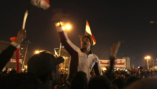 Egyptian protesters attend an opposition rally in Tahrir Square in Cairo, Egypt, Nov. 27.