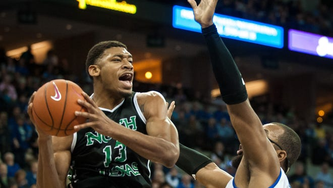 Tony Mitchell of North Texas drives to the hoop over Creighton's Gregory Echenique on November 9 in Omaha, Nebraska. Mitchell is considered a future first-round NBA draft pick.