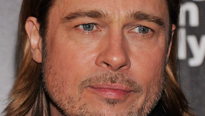 """Actor Brad Pitt attends The Cinema Society with Men's Health and DeLeon hosted screening of The Weinstein Company's """"Killing Them Softly"""" on November 26, 2012 in New York City.  (Photo by Stephen Lovekin/Getty Images)"""