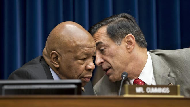 House Oversight Committee Chairman Rep. Darrell Issa, R-Calif., right, confers with the committee's ranking Democrat, Rep. Elijah Cummings, D-Md., on Capitol Hill in Washington, Wednesday, Oct. 10, 2012. The two will host hearings on HGH next week.