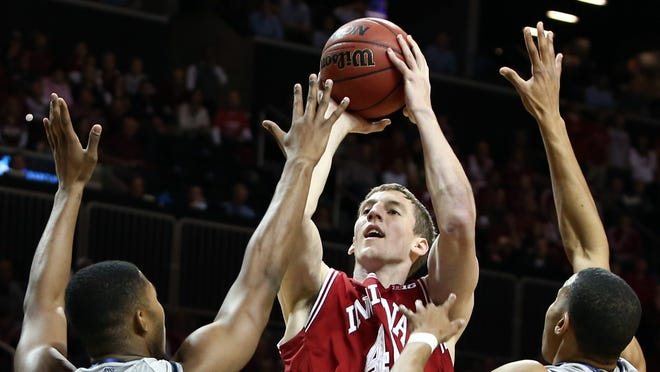 Forward Cody Zeller, center, and the Indiana Hoosiers are the top ranked team in the nation. It takes donations of $5,000 to $20,000 for non-students to sit in one of the 1,300 court level seats.