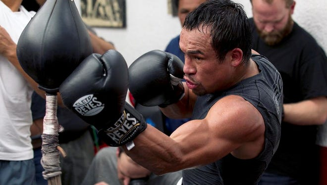 Juan Manuel Marquez works out leading up to his fourth fight against Manny Pacquiao on Dec. 8 in Las Vegas. Pacquiao has won two with one ending in a draw, but both have vowed to knock the other out this time to erase any doubt.