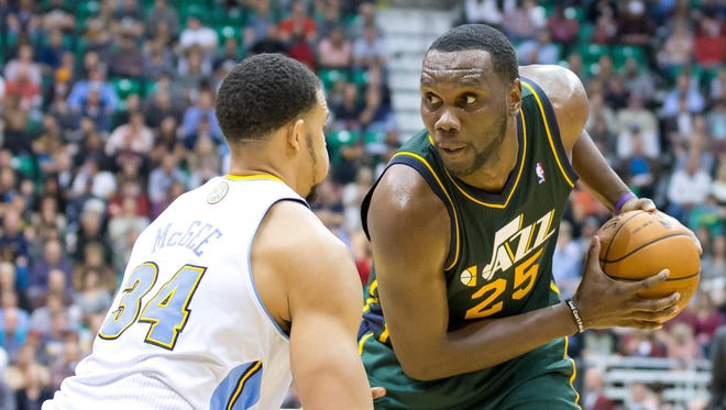 Utah's Al Jefferson squares up against Denver's JaVale McGee in the second half.