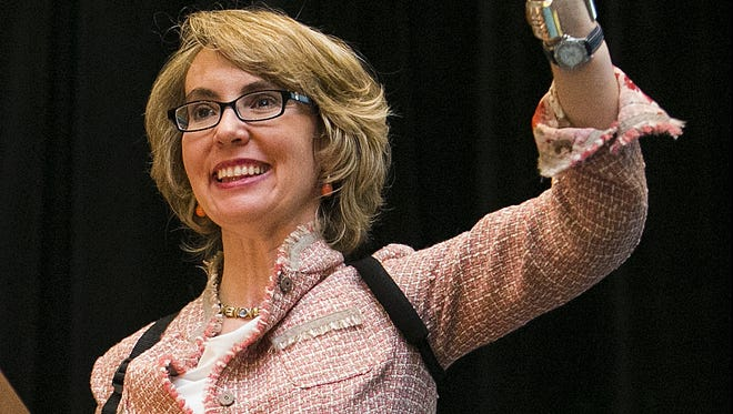 Former Rep. Gabrielle Giffords greets the crowd at the 101st Arizona Town Hall meeting at the Talking Stick Resort in Scottsdale. Giffords made a rare public appearance on her own.
