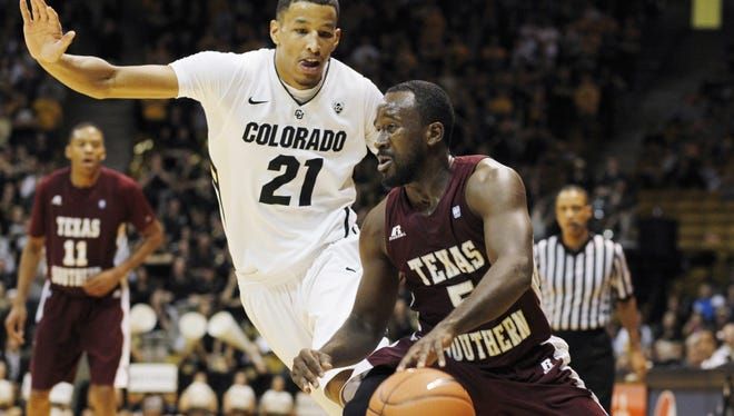 Texas Southern guard Omar Strong, front, struggles to move the ball as Colorado guard Andre Roberson covers in the first half of an NCAA college basketball game in Boulder, Colo.