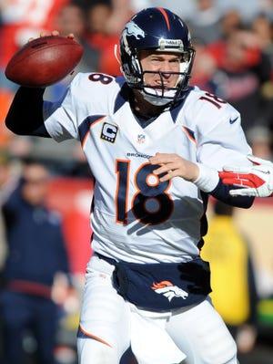 Denver Broncos quarterback Peyton Manning throws a touchdown pass against the Kansas City Chiefs in the first half at Arrowhead Stadium.