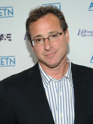 Comedian Bob Saget is writing a book, due out in 2014.