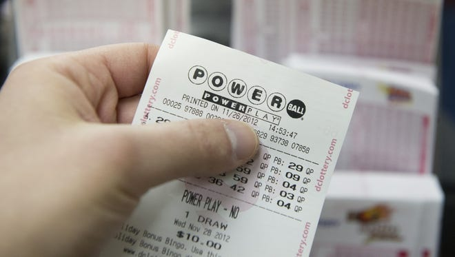 A Powerball ticket is seen at a convenience store in Washington on Monday.
