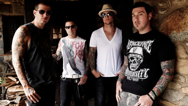 The band Avenged Sevenfold, left to right, M Shadows, Johnny Christ, Synyster Gates and Zacky Vengeance