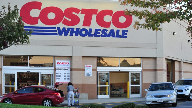 A shopper loads items into her car at Costco Wholesale Club in Manassas, Va.,  October 16, 2012.