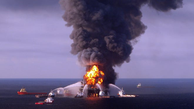 U.S. Coast Guard fire boat response crews battle the blazing remnants of the BP operated off shore oil rig, Deepwater Horizon, in the Gulf of Mexico in 2010.