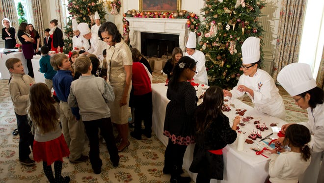 First lady Michelle Obama and dog Bo show off the decorated the White House.