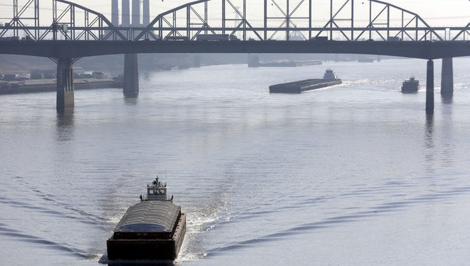 Barges navigated the Mississippi River in St. Louis two weeks ago.