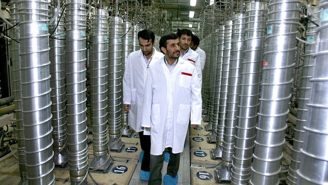 In this April 8, 2008, file photo provided by the Iranian president's office, Iranian President Mahmoud Ahmadinejad, center, visits the Natanz Uranium Enrichment Facility.
