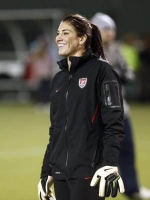 U.S. Women's  National soccer team goalie Hope Solo smiles during practice in Portland, Ore. The U.S. Team will play Ireland Wednesday in an exhibition game.